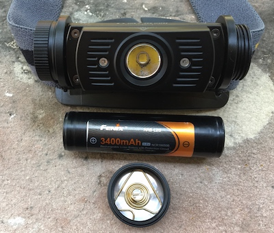 Fenix HL60R headlamp battery compartment with replaceable 18650 batteries.